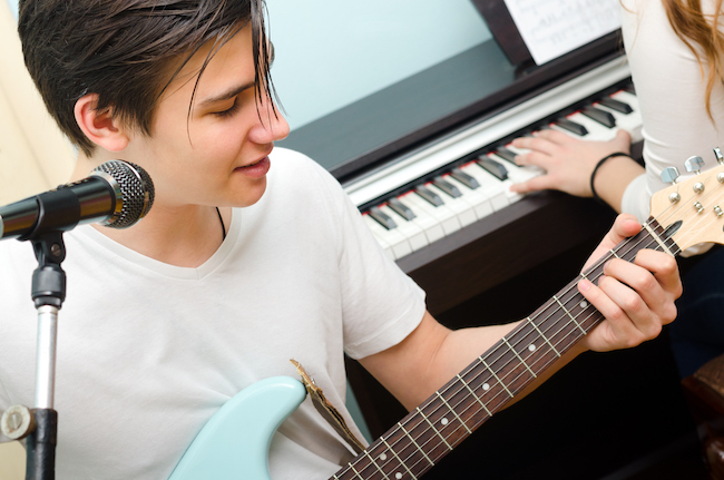 young people playing rock music together
